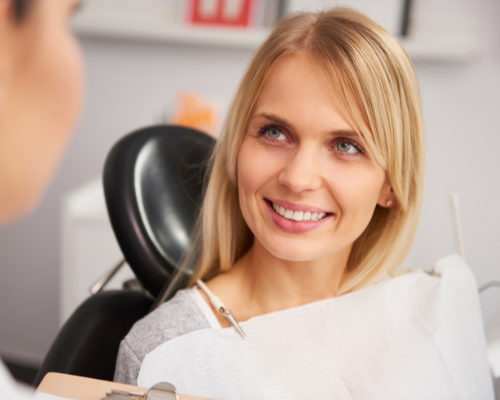 woman asking questions at dentist office
